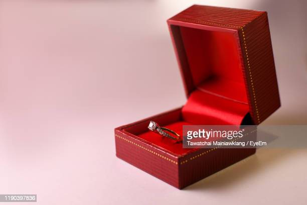 close-up of ring against white background - jewelry box stock pictures, royalty-free photos & images