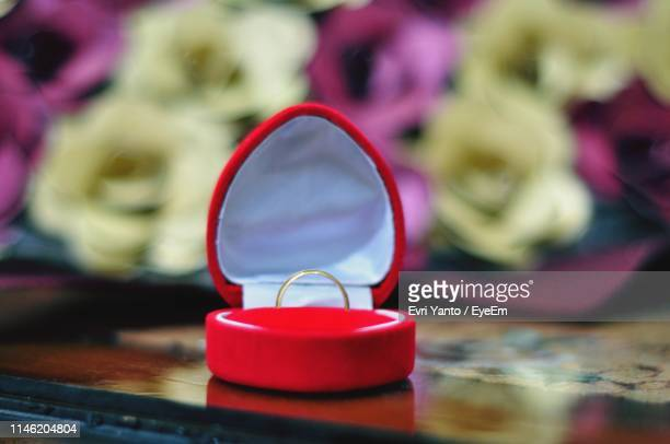 close-up of ring in jewelry box on table - jewelry box stock pictures, royalty-free photos & images