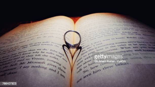 close-up of ring on book - western script stock pictures, royalty-free photos & images