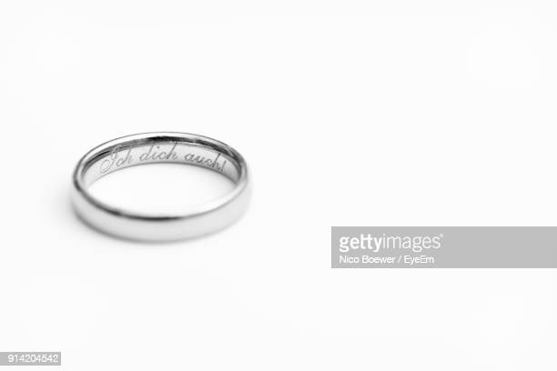 Close-Up Of Ring Over White Background
