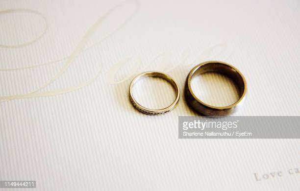 close-up of rings on table - wealth stock pictures, royalty-free photos & images