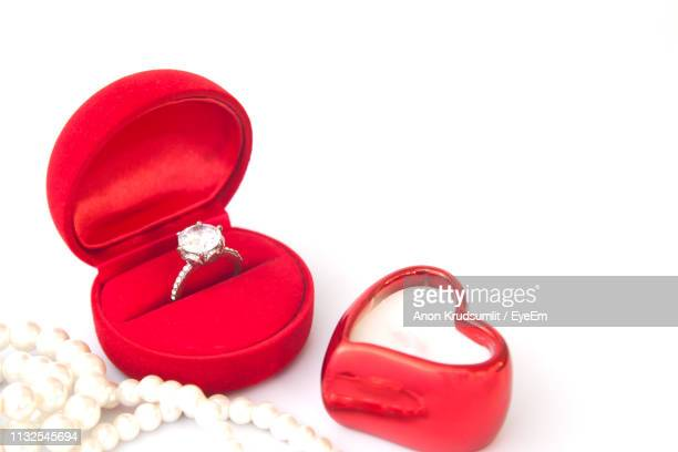 close-up of rings on white background - engagement ring box stock photos and pictures