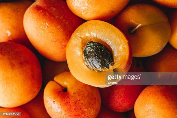 close-up of ripe apricots - apricot stock pictures, royalty-free photos & images
