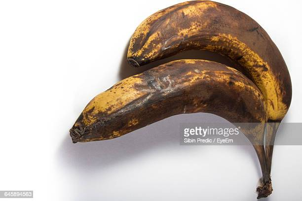 Close-Up Of Ripe Bananas Against White Background
