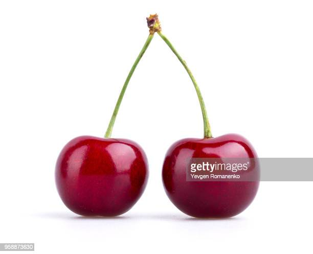Closeup of ripe cherry on white background