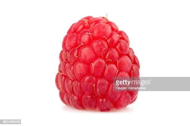 closeup of ripe raspberry on white background - lampone mora di rovo foto e immagini stock