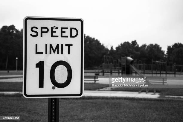 close-up of road sign against sky - speed limit sign stock photos and pictures