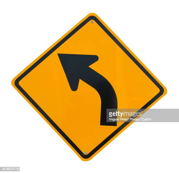 close-up of road sign against white background - road sign stock pictures, royalty-free photos & images