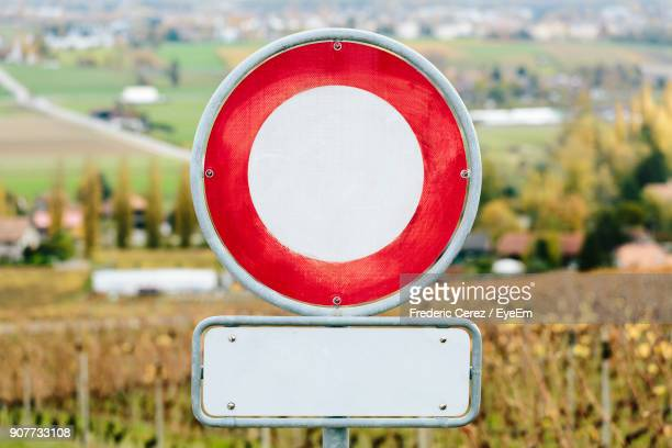 close-up of road sign on field - road sign stock pictures, royalty-free photos & images