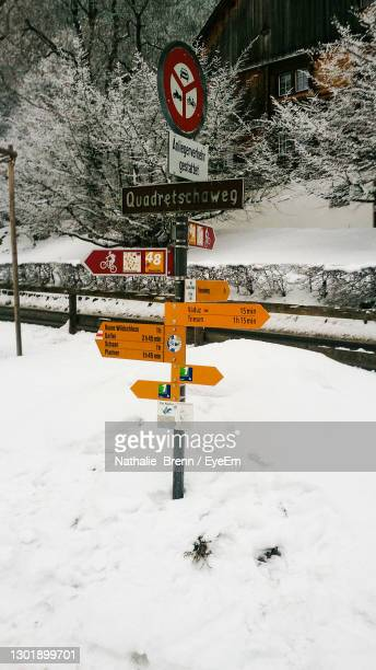 close-up of road sign on snow - vaduz stock pictures, royalty-free photos & images
