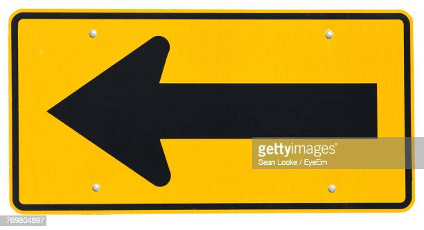 close-up of road sign over white background - road sign stock pictures, royalty-free photos & images