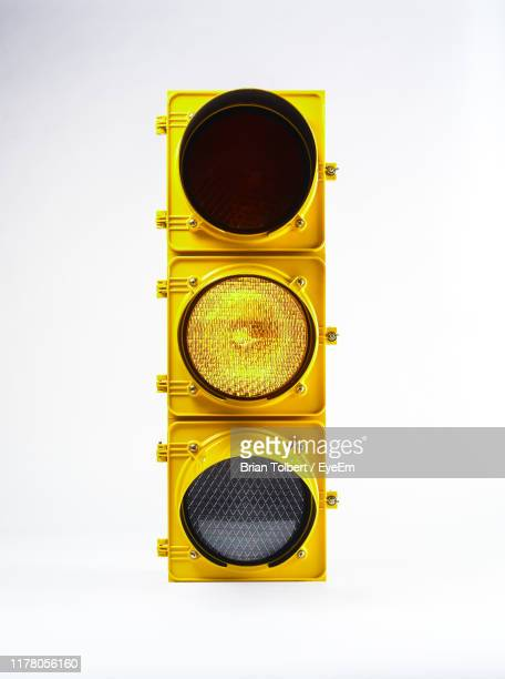 close-up of road signal against white background - stoplight stock pictures, royalty-free photos & images