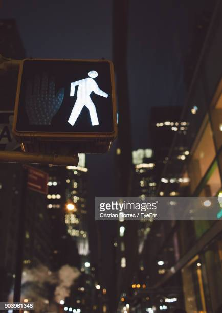 close-up of road signal at night - bortes stock pictures, royalty-free photos & images