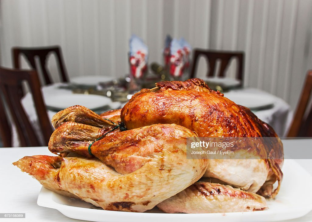 Close-Up Of Roast Turkey Served In Tray On Table At Restaurant : Stock Photo