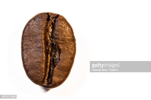 Close-Up Of Roasted Coffee Bean Over White Background