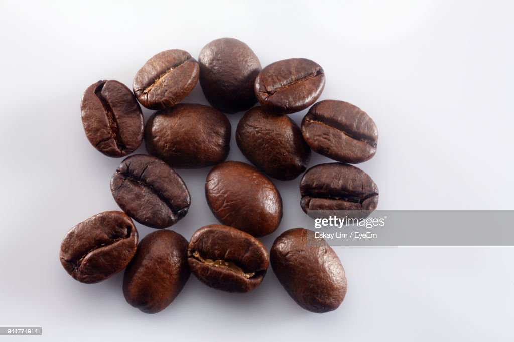 Close-Up Of Roasted Coffee Beans Against White Background : Stock Photo
