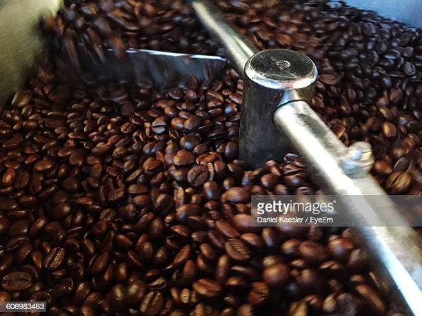 Close-Up Of Roasted Coffee Beans In Grinder