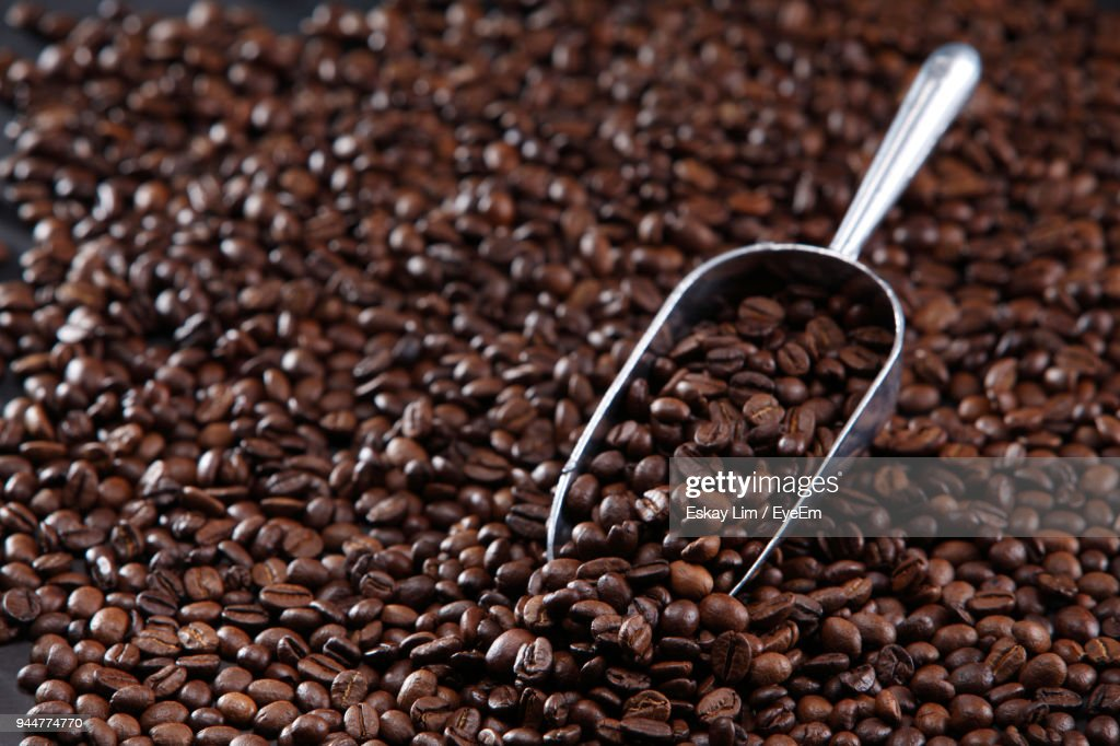 Close-Up Of Roasted Coffee Beans With Scoop : Stock Photo