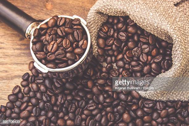 Close-Up Of Roasted Coffee Beans With Serving Scoop And Sack