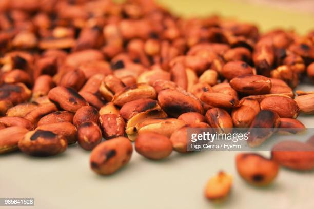 close-up of roasted peanuts on table - liga cerina stock pictures, royalty-free photos & images