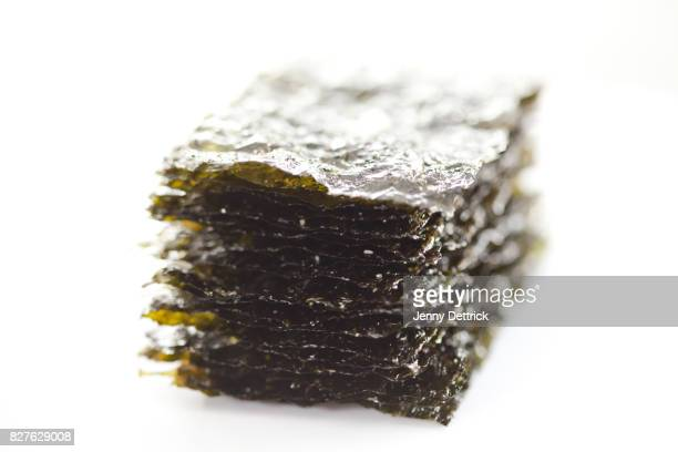 close-up of roasted seaweed - seaweed stock pictures, royalty-free photos & images