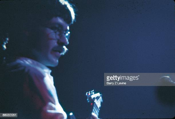 Closeup of Robbie Robertson performing at the Woodstock Music and Arts Fair in Bethel New York August 17 1969