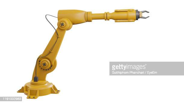 close-up of robotic arm against white background - robotic arm stock pictures, royalty-free photos & images
