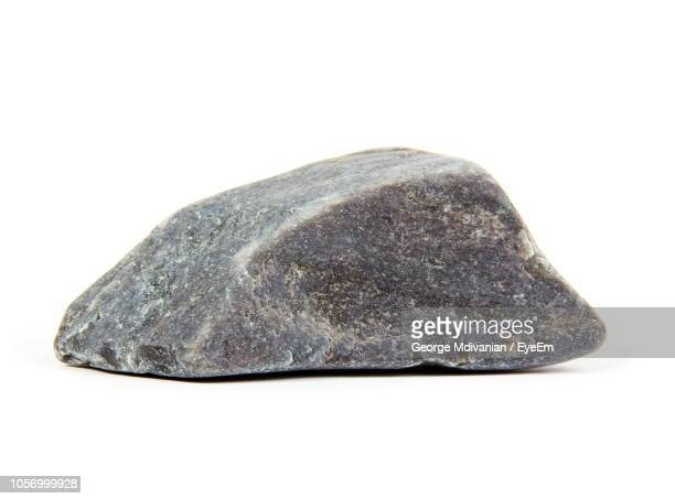 close-up of rock against white background - rock object stock pictures, royalty-free photos & images