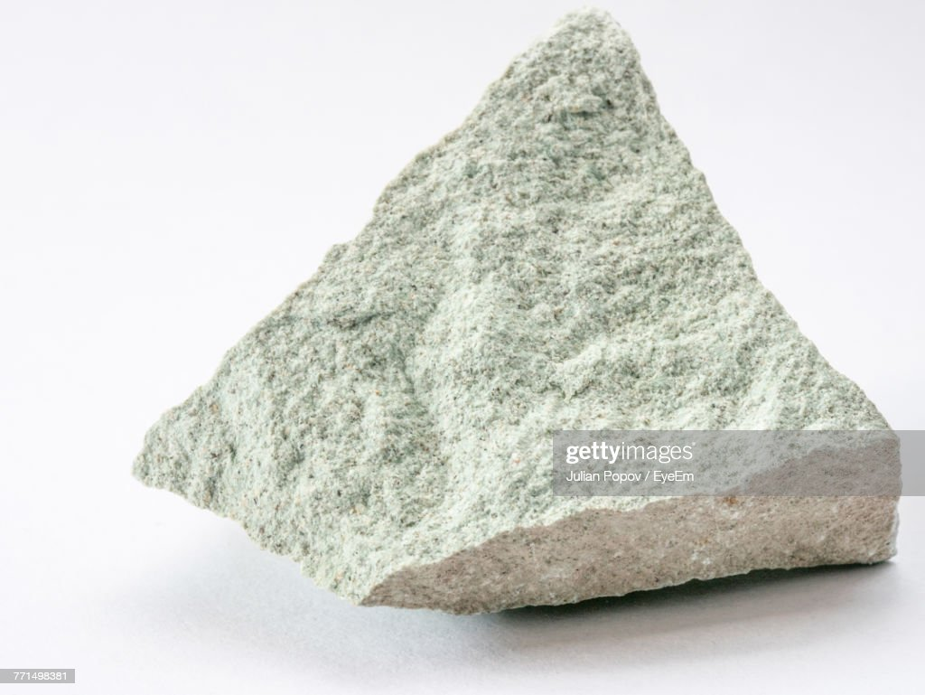 Close-Up Of Rock Against White Background : Stock Photo