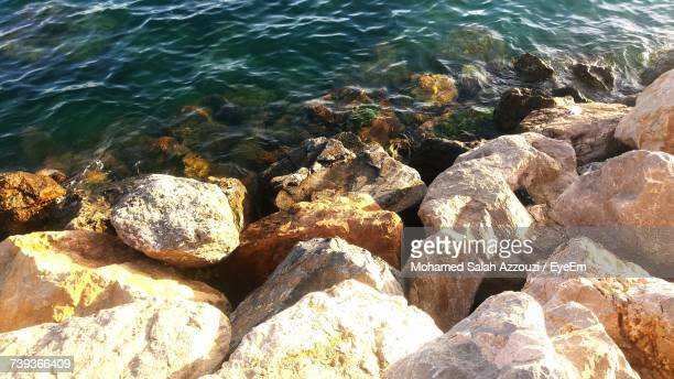 close-up of rock formation in sea - salah stock photos and pictures