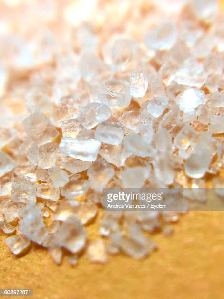 Close-Up Of Rock Salt Crystals On Table