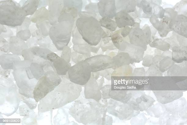 close-up of rock salt crystals (sodium chloride) - sodium stock photos and pictures