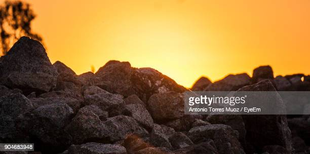 Close-Up Of Rocks Against Sky During Sunset