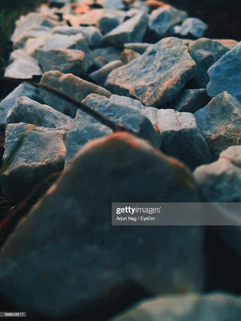 Close-Up Of Rocks On Field : Stock Photo