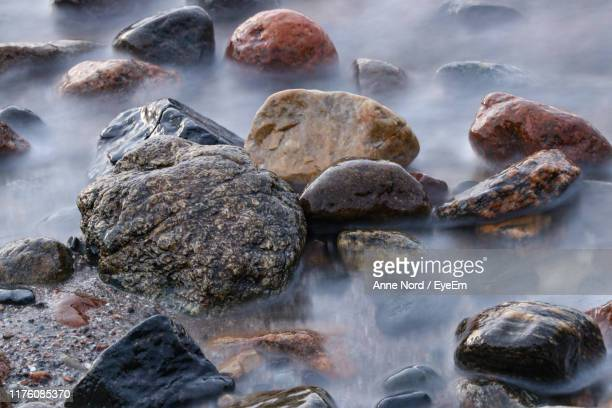 close-up of rocks on shore - soft focus stock pictures, royalty-free photos & images