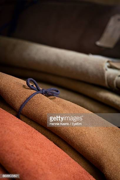 Close-Up Of Rolled Leather Fabrics At Industry