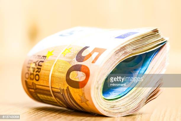 close-up of rolled up  euro banknote - twenty euro banknote stock photos and pictures