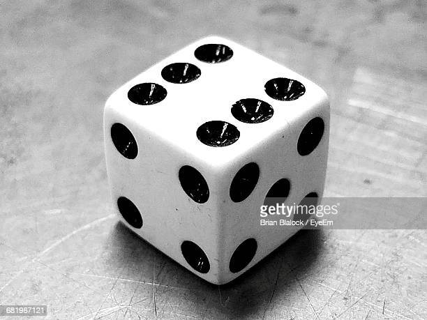 Close-Up Of Rolling Dice On Table