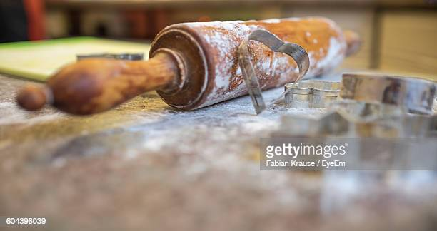 Close-Up Of Rolling Pin And Pastry Cutter On Table