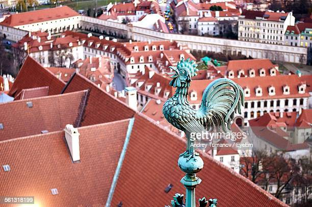 close-up of rooster weather vane on top of st vitus cathedral with cityscape - st vitus's cathedral stock pictures, royalty-free photos & images