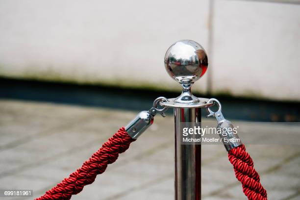 close-up of rope barrier on footpath - roped off stock photos and pictures