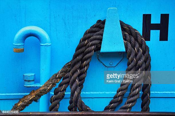 Close-Up Of Rope On Blue Metal