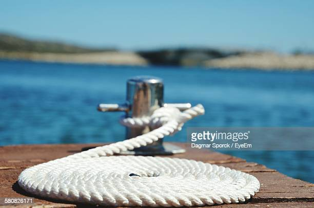 Close-Up Of Rope On Pier By Sea At Sardinia