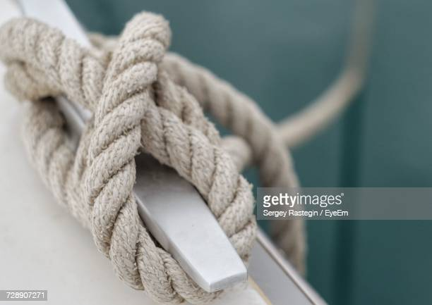 close-up of rope tied on boat - durability stock photos and pictures