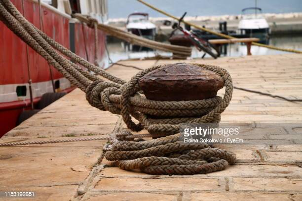 close-up of rope tied on cleat - moored stock pictures, royalty-free photos & images