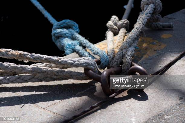 Close-Up Of Rope Tied On Metal Ring At Pier