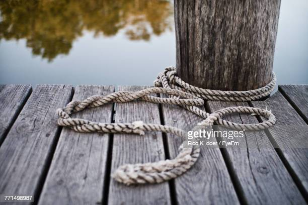 Close-Up Of Rope Tied On Wooden Jetty