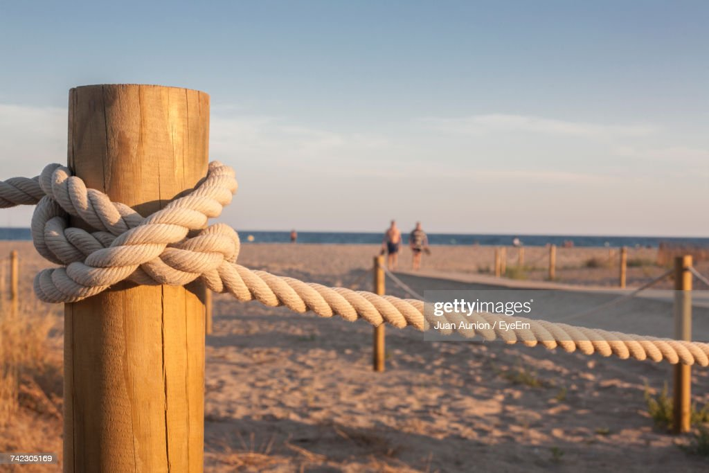 Close-Up Of Rope Tied On Wooden Post : Stock Photo