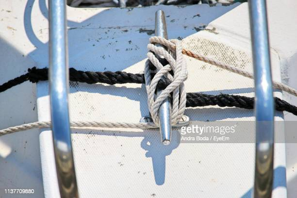 close-up of rope tied to cleat on boat - cleats stock pictures, royalty-free photos & images