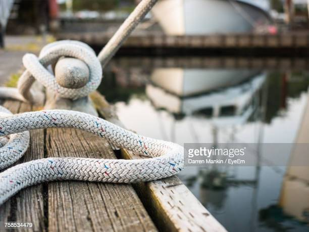 close-up of rope tied to cleat - moored stock pictures, royalty-free photos & images